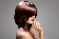Beauty model with perfect long glossy brown hair.