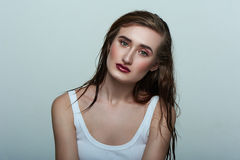 Beauty Model with perfect Skin, wet Hair and dark Lips Stock Photo