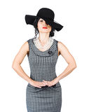 Beauty model posing in classy outfit with hat Royalty Free Stock Image