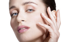 Beauty model showing clean fresh healthy skin. On white Royalty Free Stock Photos