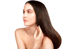 Beauty model showing perfect skin and long healthy brown hair Royalty Free Stock Photography