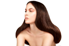 Beauty model showing perfect skin and long healthy brown hair Royalty Free Stock Photo
