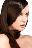 Beauty model showing perfect skin and long healthy brown hair Royalty Free Stock Image