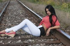 Beauty model sitting on the railroad stock photos