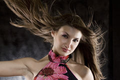 Beauty model in studio with hair blown by wind.  royalty free stock images