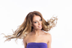 Beauty model in studio with hair blown by wind. Stock Images