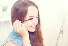 Beauty model teenage girl applying mascara royalty free stock photos