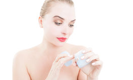 Beauty model using face creme Stock Images