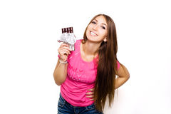 Beauty model woman eating dark chocolate. Beautiful Surprised young woman takes chocolate sweets,smiling and having fun Stock Photos