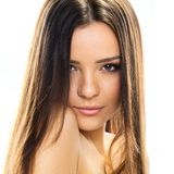 Beauty Model Woman Face. Portrait of a young brunette woman. Styled Fashion Portrait. Professional Make-up Royalty Free Stock Image