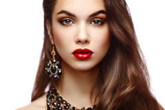 Beauty Model Woman with Long Brown Wavy Hair. Healthy Hair and Beautiful Professional Makeup. Red Lips and Smoky Eyes Make up. Gorgeous Glamour Lady Portrait Royalty Free Stock Photography