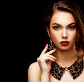 Beauty Model Woman with Long Brown Wavy Hair. Healthy Hair and Beautiful Professional Makeup. Red Lips and Smoky Eyes Make up. Gorgeous Glamour Lady Portrait Stock Photography