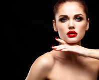 Beauty Model Woman with Long Brown Wavy Hair. Healthy Hair and Beautiful Professional Makeup. Red Lips and Smoky Eyes Royalty Free Stock Photography