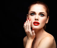 Beauty Model Woman with Long Brown Wavy Hair. Healthy Hair and Beautiful Professional Makeup. Red Lips and Smoky Eyes. Make up. Gorgeous Glamour Lady Portrait Stock Images
