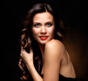 Beauty Model Woman with Long Brown Wavy Hair. Healthy Hair and Beautiful Professional Makeup. Red Lips and Smoky Eyes. Make up. Gorgeous Glamour Lady Portrait stock photos