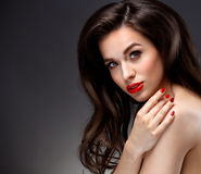 Beauty Model Woman with Long Brown Wavy Hair. Red Royalty Free Stock Photos