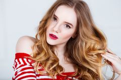 Beauty Model Woman with Long Wavy Hair. Healthy Hair and Beautiful Professional Makeup with Red Lips. Gorgeous Glamour. Lady Portrait. Haircare, Skincare Royalty Free Stock Photos