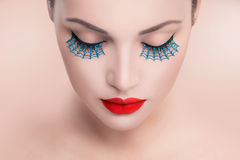 Beauty model woman with red sexy lips and blue false eyelashes Royalty Free Stock Image