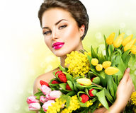 Beauty model woman with spring flowers Stock Photo