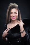 Beauty model woman wearing fur coat, diamond crown Stock Photography
