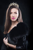 Beauty model woman wearing fur coat, diamond crown Royalty Free Stock Photography