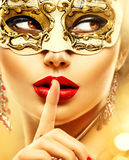 Beauty model woman wearing venetian mask. Beauty model woman wearing venetian masquerade carnival mask at party Stock Photo