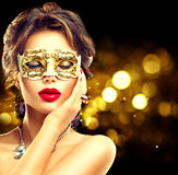 Beauty model woman wearing venetian mask Royalty Free Stock Image