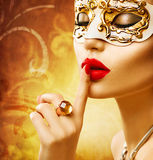 Beauty model woman wearing venetian mask Stock Images