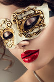 Beauty model woman wearing venetian mask Royalty Free Stock Photography