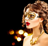 Beauty model woman wearing venetian masquerade carnival mask. At party royalty free stock photography