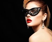 Beauty model woman wearing venetian masquerade carnival mask at party isolated on black background. Christmas and New. Year celebration. Glamour lady with royalty free stock images