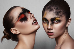 Beauty Models with art Makeup on shiny Skin. Beauty fashion Models with art Makeup on shiny Skin Royalty Free Stock Image