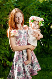 Beauty Mom and baby outdoors. Happy family playing in nature. Mo Royalty Free Stock Photos