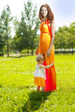 Beauty Mom and baby outdoors. Happy family playing in nature. Mo Royalty Free Stock Image