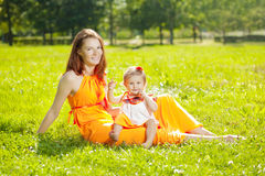 Beauty Mom and baby outdoors. Happy family playing in nature. Mo Stock Photography