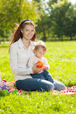 Beauty Mom and baby outdoors. Happy family playing in nature. Mo Stock Photos