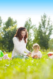 Beauty Mom and baby outdoors. Happy family playing in nature. Mo Royalty Free Stock Photo