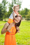 Beauty Mom and baby outdoors. Happy family playing in nature. Mo royalty free stock images