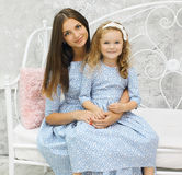 Beauty mother and daughter in Royalty Free Stock Photo