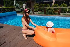 Beauty mother with littel son by the pool royalty free stock photos