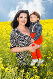 Beauty mother and toddler son in nature Royalty Free Stock Photography