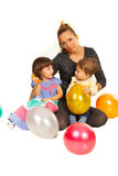 Beauty mother with two kids at party Royalty Free Stock Photography