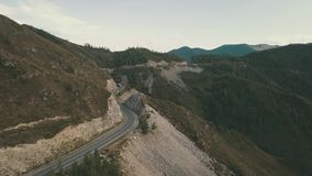 Beauty mountain. 4K. Aerial Drone Footage View: A landscape view of beautiful fresh field and Altai mountain background.Flight over autumn mountain with highway stock video footage