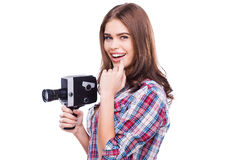 Beauty with movie camera. Royalty Free Stock Image