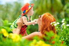 Beauty Mum and her Child playing in outdoor together Stock Image