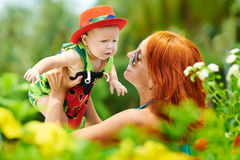 Beauty Mum and her Child playing in outdoor together Royalty Free Stock Photography