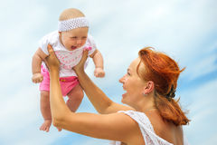 Beauty Mum and her Child playing in outdoor together Stock Photo