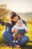 Beauty Mum and her Child playing in Park Royalty Free Stock Photos
