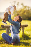 Beauty Mum and her Child playing in Park Royalty Free Stock Image