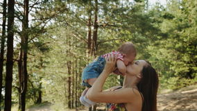Beauty Mum and her Child playing in Park together stock video
